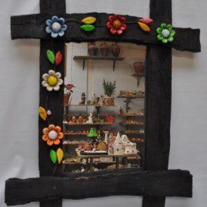 Espejo de madera y flores